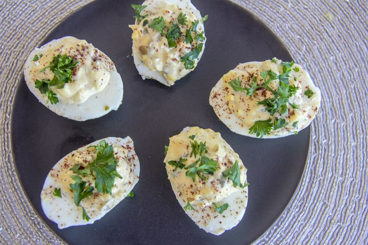 hard boiled eggs stuffed with lemon and capers