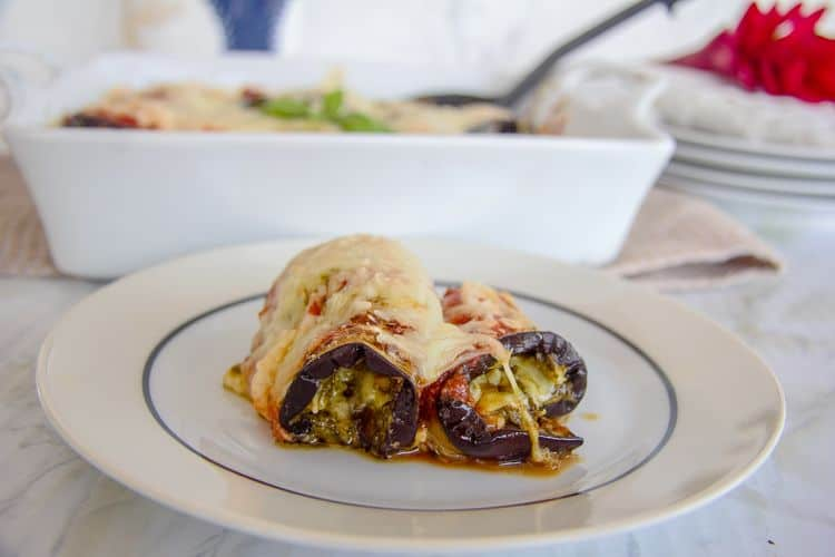 Eggplant slices rolled and stuffed with cheese and pesto