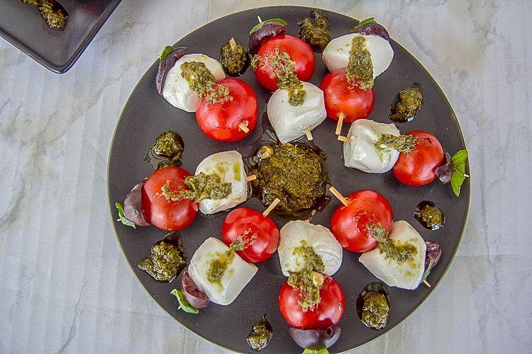 mini tomatoes and mozzarella on a toothpick