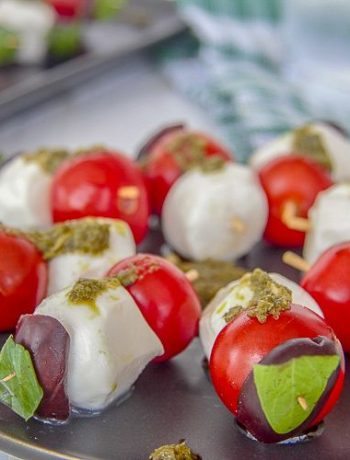 cherry tomatoes and mozzarella balls on a stick