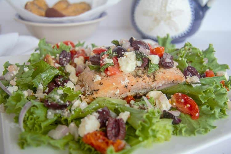 greek salmon covered with feta and olives