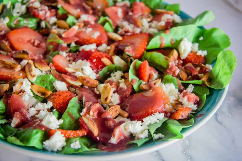salad with strawberries, arugula, feta and almonds