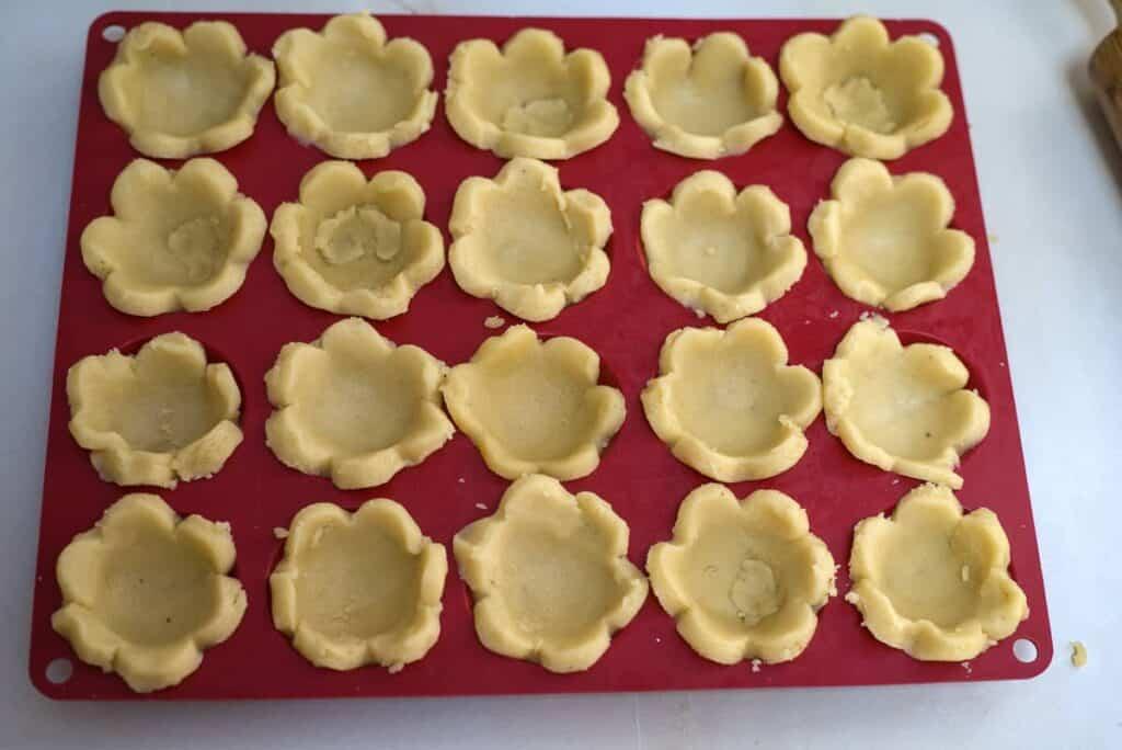 mini muffin tin with cookie dough
