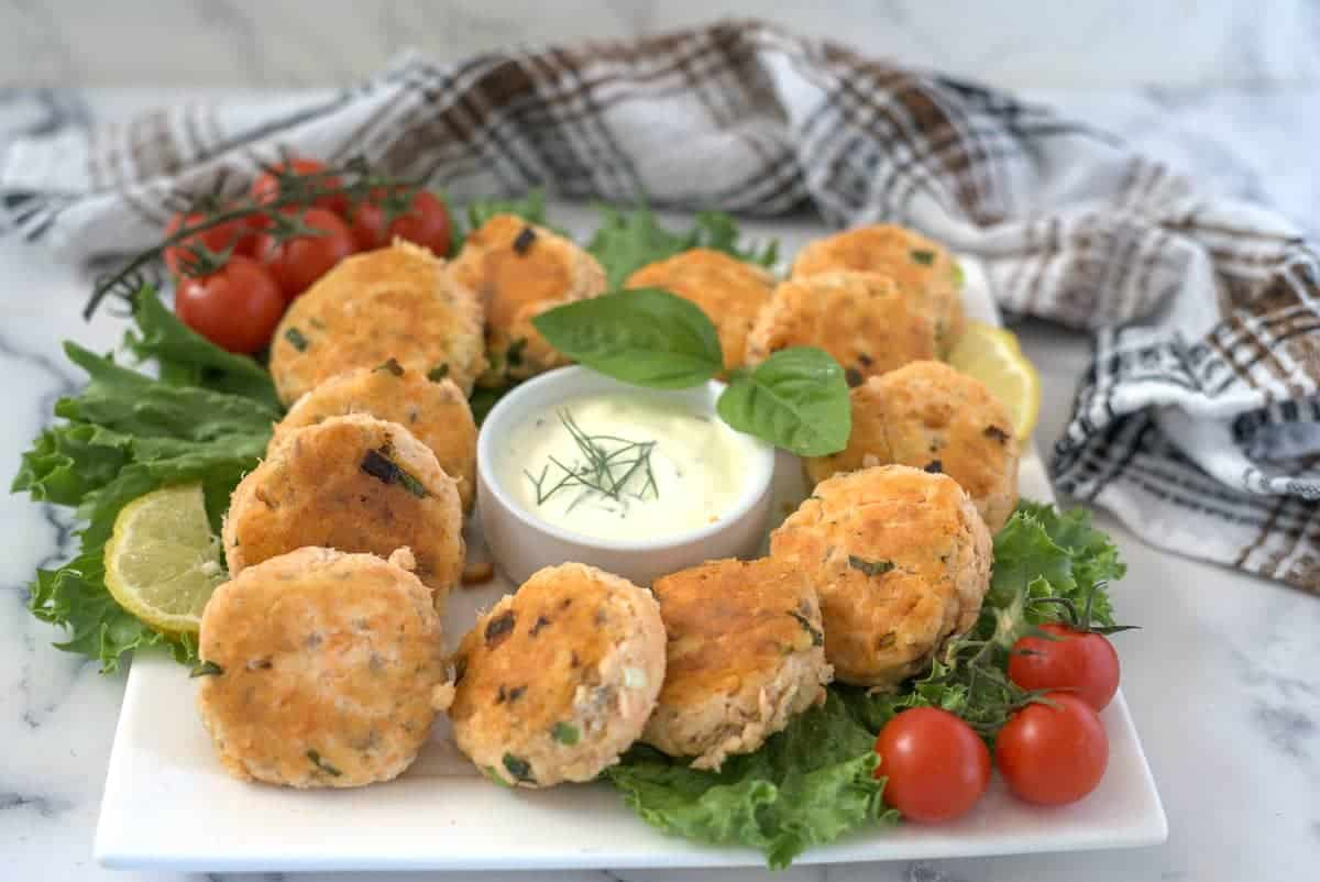 salmon patties with a dip