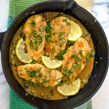 chicken piccata in a skillet pan