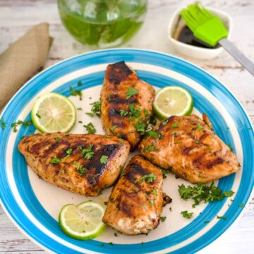 bbq chicken breasts on a plate