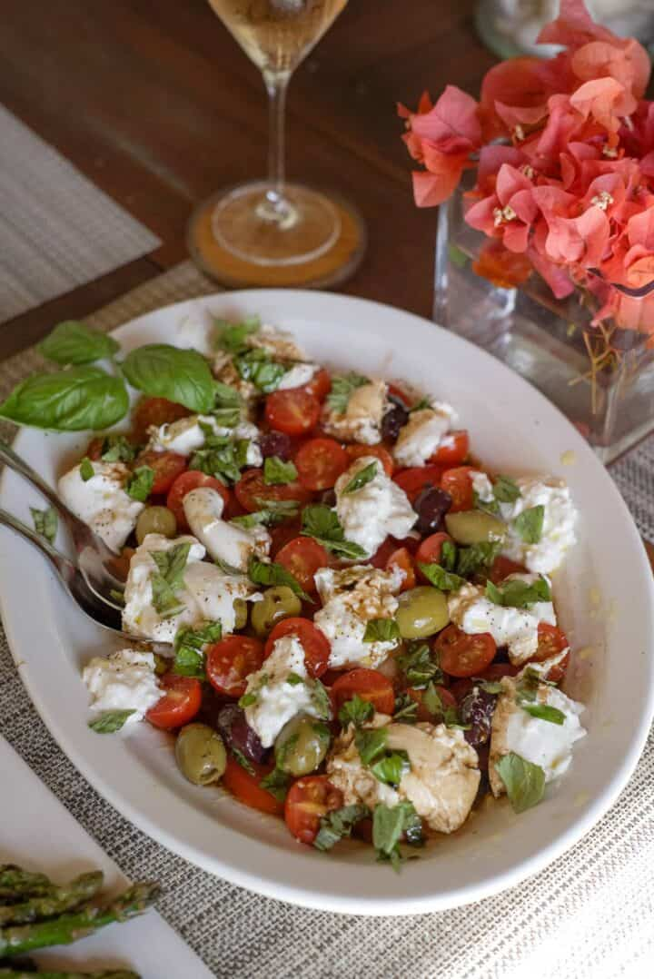 tomatoes and olives with burrata cheese